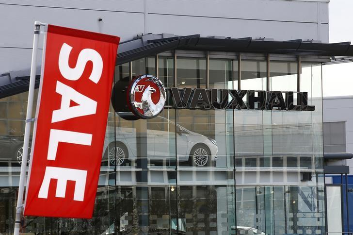 A Vauxhall dealership advertises a sale on its vehicles near the Vauxhall plant in Luton
