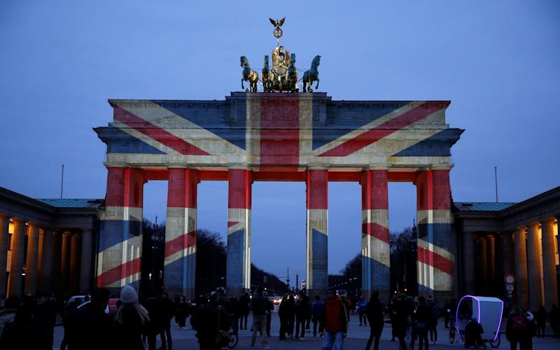 The Brandenburg Gate is illuminated with the colours of the British flag to show solidarity with the victims of the recent attack in London - Reuters