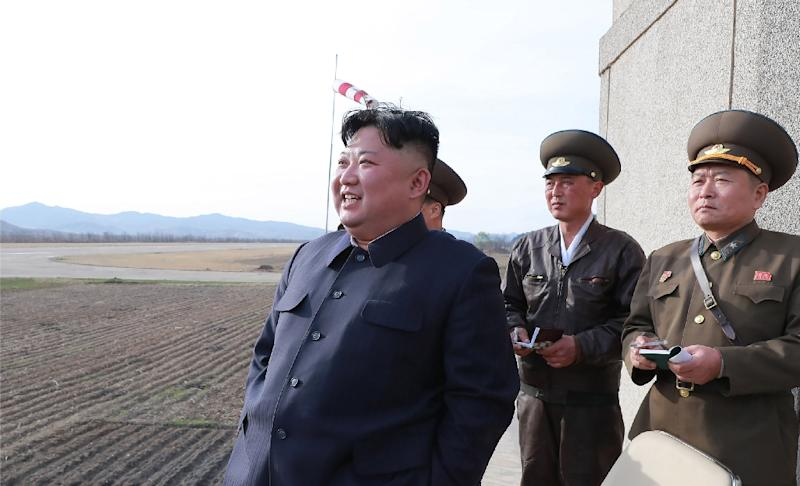 "A diplomatic source said plans for an April summit could still change, noting that Kim Jong Un (L) was an ""impulsive person"" (AFP Photo/KCNA VIA KNS)"