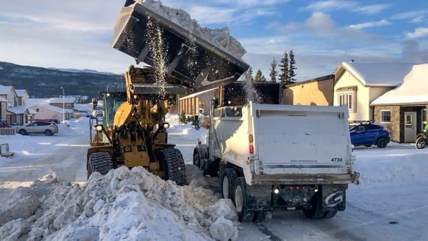 A loader clears a street in Whitehorse last month.