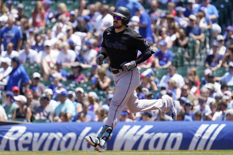 Miami Marlins' Adam Duvall rounds the bases after hitting a two-run home run in the first inning of a baseball game against the Chicago Cubs in Chicago, Saturday, June 19, 2021. (AP Photo/Nam Y. Huh)