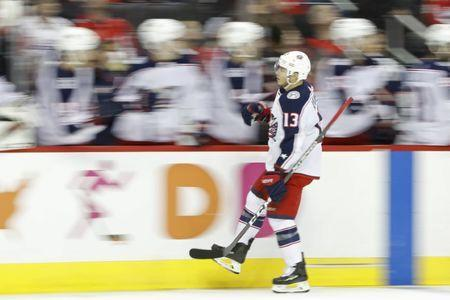 Jan 12, 2019; Washington, DC, USA; Columbus Blue Jackets right wing Cam Atkinson (13) celebrates with teammates after scoring a goal against the Washington Capitals in the first period at Capital One Arena. Mandatory Credit: Geoff Burke-USA TODAY Sports