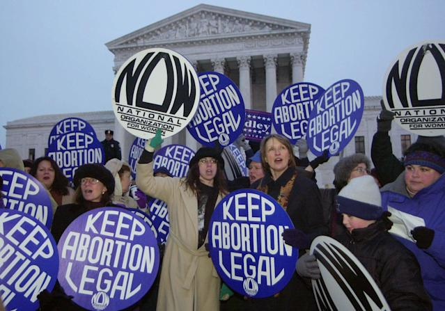 Patricia Ireland, President of National Organization for Women (NOW), third from right, demonstrates with other NOW participants in favor of the Roe vs. Wade decision during the candlelight vigil on the steps of the Supreme Court in Washington, Saturday Jan. 22, 2000. (AP Photo/Stephen Boitano)