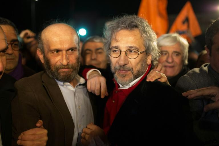 Turkish opposition journalists Erdem Gul (left) and Can Dundar talk to reporters after being freed from Silivri prison in Istanbul, on February 26, 2016