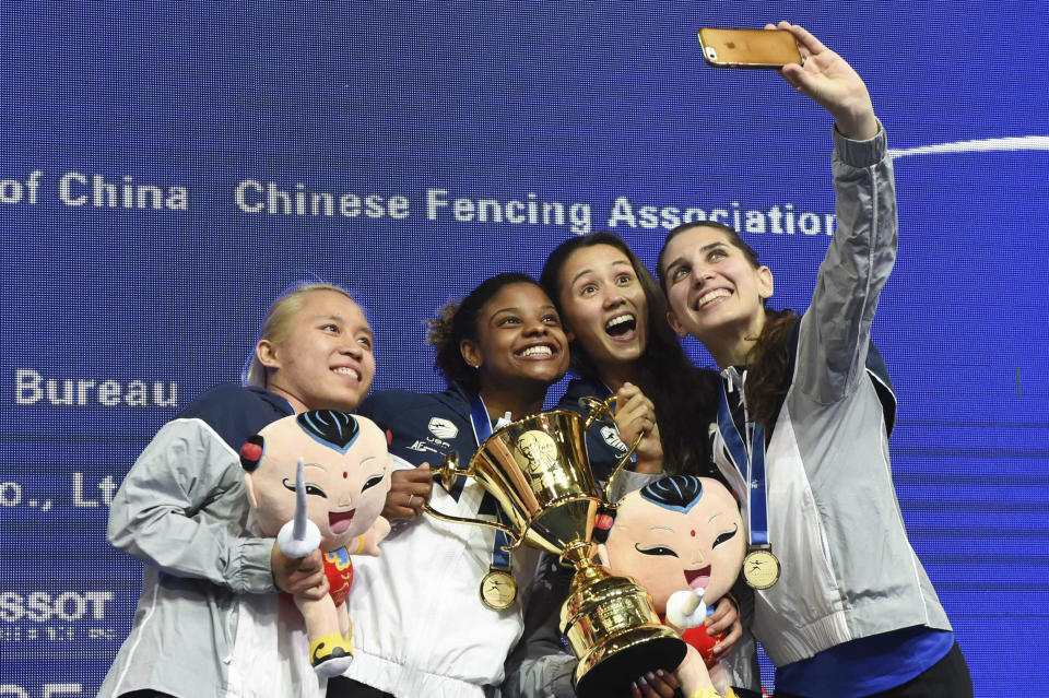 Members of the U.S. women's fencing team — from left, Margaret Lu, Nzingha Prescod, Lee Kiefer, and Nicole Ross — pose for a selfie with their medals after winning the team women's foil finals at the Fencing World Championships in China in 2018. They were the first American squad to win a senior world championship in the foil discipline.
