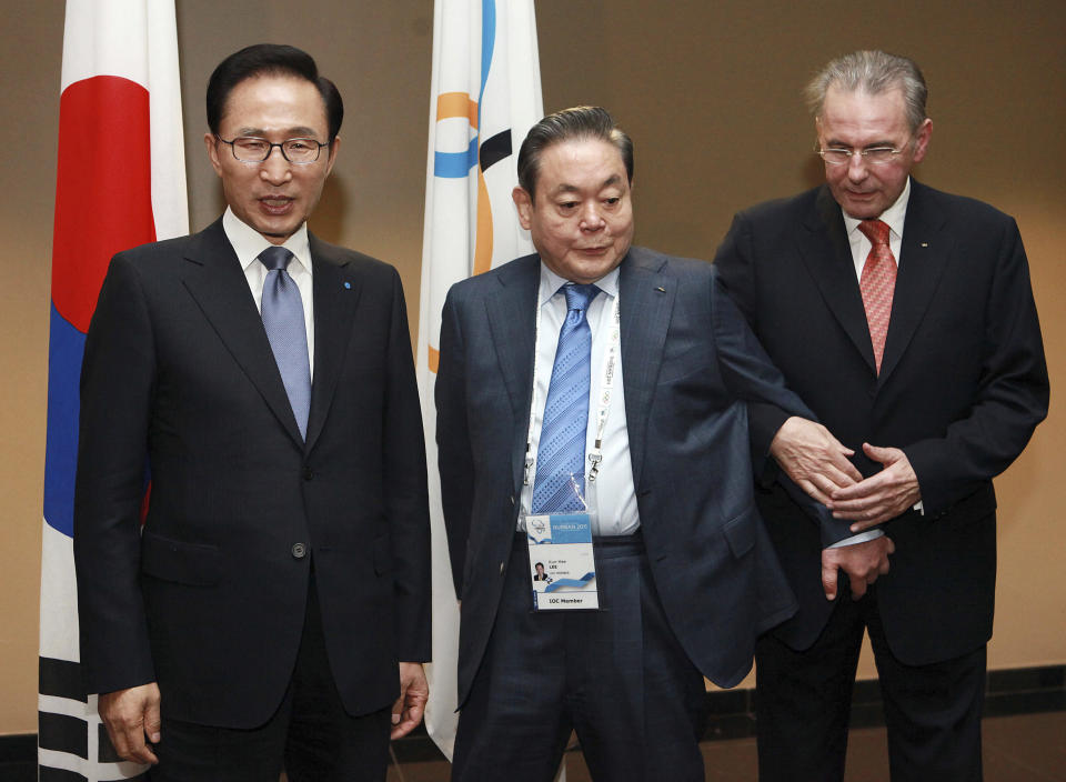 FILE - In this July 5, 2011, file photo, President of the International Olympic Committee (IOC) Jacques Rogge, right, meets with South Korean President Lee Myung-bak, left, and Samsung Chairman Lee Kun-hee in Durban, South Africa, ahead the opening ceremony for the 123rd IOC session that would decide the host city for the 2018 Olympics Winter Games. Lee, the ailing Samsung Electronics chairman who transformed the small television maker into a global giant of consumer electronics, has died, a Samsung statement said Sunday, Oct. 25, 2020. He was 78. (AP Photo/Rajesh Jantilal-Pool, Pool, File)