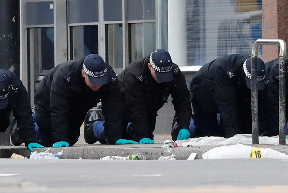 Police conduct a finger tip search following the terror attack in Streatham High Road (Aaron Chown/PA) (PA Archive)
