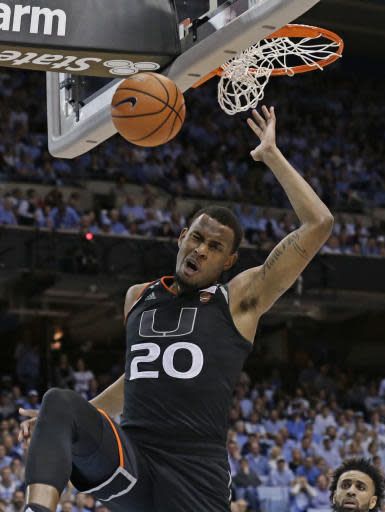 Miami's Dewan Huell (20) dunks against North Carolina during the second half of an NCAA college basketball game in Chapel Hill, N.C., Tuesday, Feb. 27, 2018. Miami won 91-88. (AP Photo/Gerry Broome)