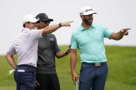 Rory McIlroy, of Northern Ireland, left, and Dustin Johnson, right, point from the second tee box during a practice round of the U.S. Open Golf Championship, Wednesday, June 16, 2021, at Torrey Pines Golf Course in San Diego. (AP Photo/Jae C. Hong)