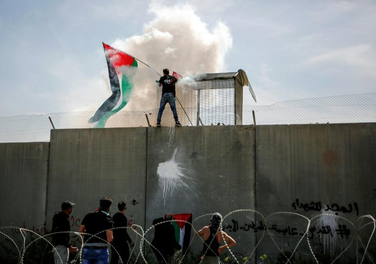 Israel's separation wall -- a cursed symbol of the occupation for Palestinians -- cuts the West Bank off from Israel and annexed Arab east Jerusalem and is the scene of regular protests