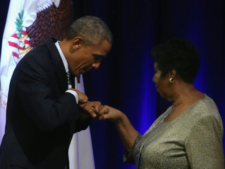 """US President Barack Obama fist bumps with singer Aretha Franklin, who he said """"helped define the American experience"""""""