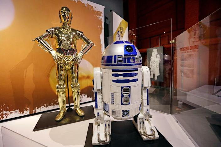 C-3PO, left, and R2-D2 costumes. (AP Photo/Elaine Thompson)