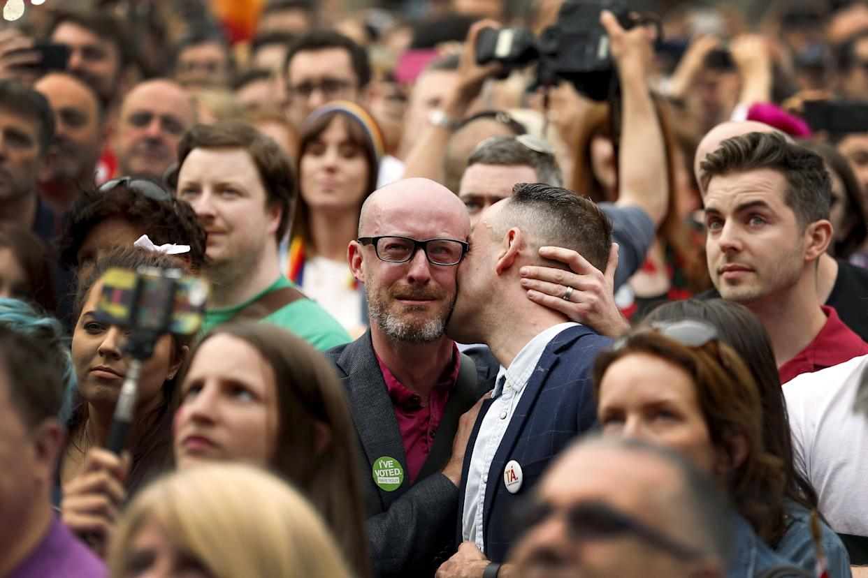 People react as Ireland voted in favour of allowing same-sex marriage in a historic referendum, in Dublin May 23, 2015. Ireland became the first country in the world to adopt same-sex marriage by popular vote as 62 percent of the electorate backed a referendum, official results showed on Saturday. REUTERS/Cathal McNaughton TPX IMAGES OF THE DAY