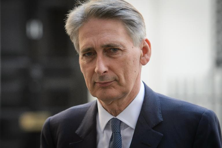 Britain's Foreign Secretary Philip Hammond leaves Downing Street, central London, on August 20, 2014, after a meeting to discuss the ongoing crisis involving the Islamic State radical group (AFP Photo/Leon Neal)
