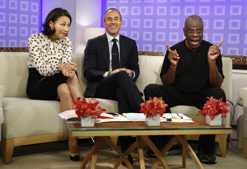 """This image released by NBC shows co-hosts Ann Curry, left, and Matt Lauer, center, with actor Jimmie Walker from the 1970s series """"Good Times,"""" on the """"Today"""" show, Tuesday, June 26, 2012 in New York. Walker was promoting his memoir """"Dynomite!: Good Times, Bad Times, Our Times."""" Curry got thumped by a """"Today"""" TV camera Tuesday, during a crowd-panning sequence out on Rockefeller Plaza. Curry's face collided with the camera lens on live TV. (AP Photo/NBC, Peter Kramer)"""