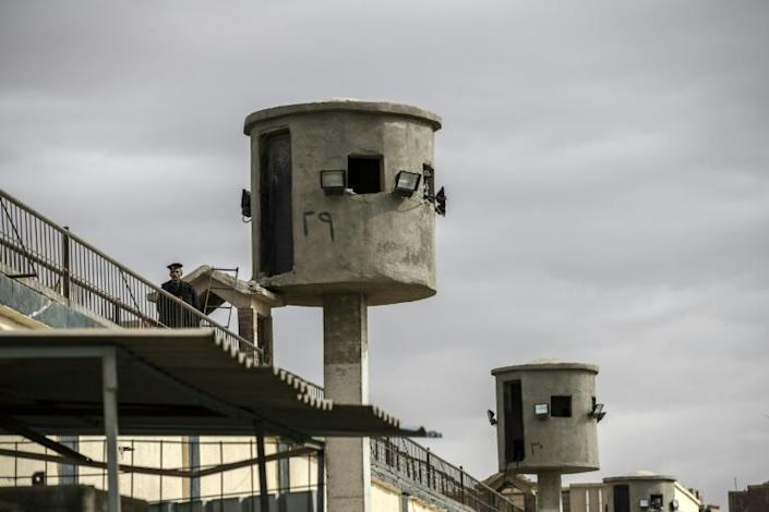 "Watch towers at Tora prison on the outskirts of the Egyptian capital. In a practice dubbed by the country's legal and activist community as ""recycling"" or ""rotation"", inmates can end up in detention indefinitely."