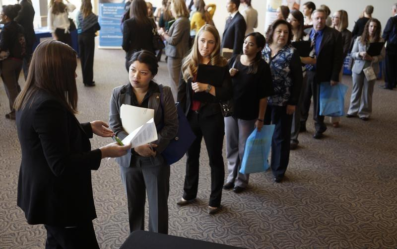 seJobseekers wait to talk to a recruiter at the Colorado Hospital Association's health care career event in Denver