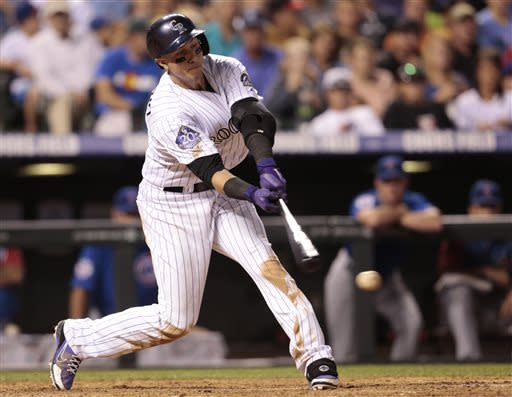Colorado Rockies' Troy Tulowitzki strikes out against the Chicago Cubs in the seventh inning of a baseball game in Denver, Friday, July 19, 2013.(AP Photo/Joe Mahoney)