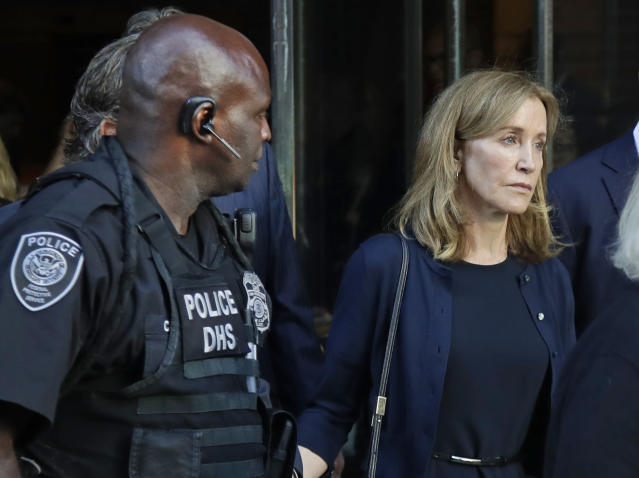 Felicity Huffman leaves federal court after her sentencing in a nationwide college admissions bribery scandal, Friday, Sept. 13, 2019, in Boston. (AP Photo/Elise Amendola)