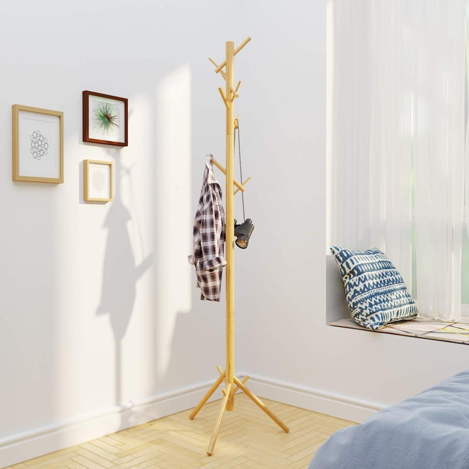 """<p>You can't go wrong with this affordable <a href=""""https://www.popsugar.com/buy/Bameos-Bamboo-Tree-Coat-Rack-518261?p_name=Bameos%20Bamboo%20Tree%20Coat%20Rack&retailer=amazon.com&pid=518261&price=17&evar1=casa%3Aus&evar9=46905095&evar98=https%3A%2F%2Fwww.popsugar.com%2Fphoto-gallery%2F46905095%2Fimage%2F46905100%2FPerfect-Bamboo-Coat-Rack&list1=shopping%2Camazon%2Ccoats%2Cwinter%2Csmall%20spaces%2Csmall%20space%20living%2Cdecor%20inspiration&prop13=api&pdata=1"""" rel=""""nofollow"""" data-shoppable-link=""""1"""" target=""""_blank"""" class=""""ga-track"""" data-ga-category=""""Related"""" data-ga-label=""""https://www.amazon.com/BAMEOS-Bamboo-Stand-Assembly-Required/dp/B07QMS4YHG/ref=sr_1_13?crid=1MQZSY97MIH5A&amp;keywords=coat+rack&amp;qid=1573832854&amp;sprefix=coat+ra%2Caps%2C241&amp;sr=8-13"""" data-ga-action=""""In-Line Links"""">Bameos Bamboo Tree Coat Rack</a> ($17).</p>"""