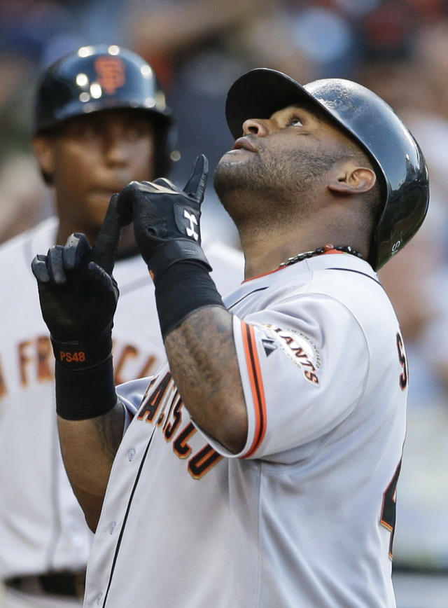 San Francisco Giants' Pablo Sandoval points skyward after hitting his third home run of a baseball game against the San Diego Padres during the ninth inning on Wednesday, Sept. 4, 2013, in San Diego. (AP Photo/Gregory Bull)