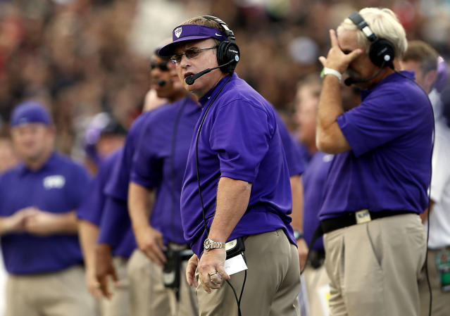 TCU's Gary Patterson watches as his team competes against Texas Tech during their NCAA college football game in Lubbock, Texas, Thursday, Sept. 12, 2013. (AP Photo/Lubbock Avalanche-Journal, Stephen Spillman)