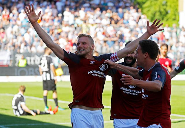 Soccer Football - 2. Bundesliga - SV Sandhausen v Nuremberg - BWT-Stadion am Hardtwald, Sandhausen, Germany - May 6, 2018 Nurnberg 's Hanno Behrens celebrates scoring their first goal with team mates REUTERS/Kai Pfaffenbach DFL RULES TO LIMIT THE ONLINE USAGE DURING MATCH TIME TO 15 PICTURES PER GAME. IMAGE SEQUENCES TO SIMULATE VIDEO IS NOT ALLOWED AT ANY TIME. FOR FURTHER QUERIES PLEASE CONTACT DFL DIRECTLY AT + 49 69 650050