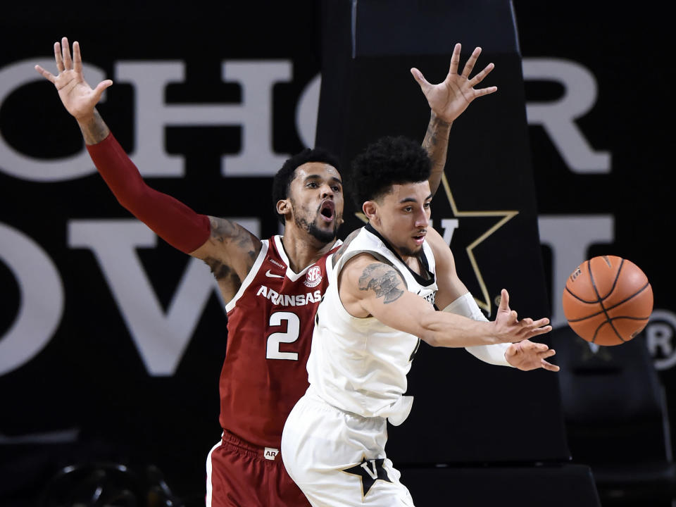Vanderbilt guard Scotty Pippen Jr. (2) passes the ball away from Arkansas forward Vance Jackson (2) during the second half of an NCAA college basketball game against Vanderbilt Saturday, Jan. 23, 2021, in Nashville, Tenn. Arkansas won 92-71. (AP Photo/Mark Zaleski)