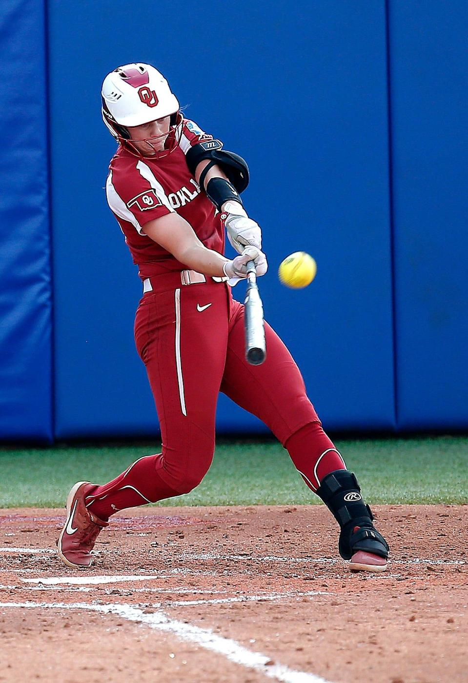Oklahoma's Jana Johns (20) hits a home run in the third inning during the second game of Women's College World Series championship series between University of Oklahoma (OU) and Florida State University at the USA Softball Hall of Fame Stadium in Oklahoma City, Wednesday, June 9, 2021. Oklahoma won 6-2.