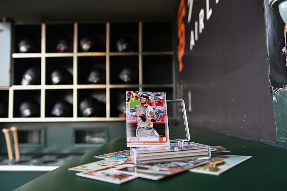 SAN FRANCISCO, CA - AUGUST 06:  A stack of San Francisco Giants First base Brandon Belt (9) Topps trading cards sitting in the dugout before the MLB game between the Washington Nationals and the San Francisco Giants at Oracle Park on August 6, 2019 in San Francisco CA. (Photo by Stephen Hopson/Icon Sportswire via Getty Images)