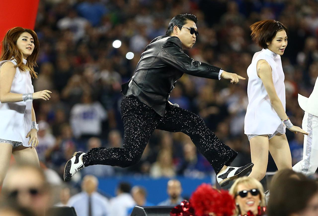 TORONTO, ON - DECEMBER 16: Korean rapper Psy performs at halftime during the Seattle Seahawks NFL game against the Buffalo Bills at Rogers Centre on December 16, 2012 in Toronto, Ontario, Canada. (Photo by Tom Szczerbowski/Getty Images)