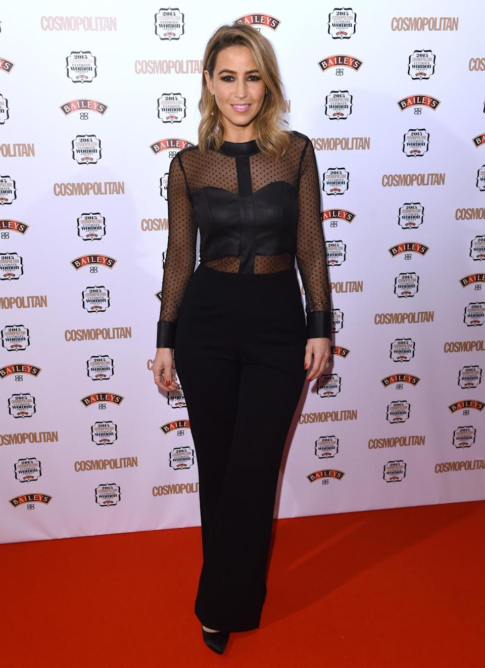 Rachel Stevens showed off her taut tum in a semi-sheer polka dot top, paired with black trousers. [Photo: Rex]