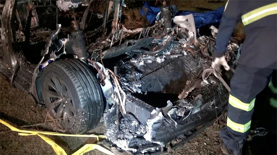 The remains of a Tesla vehicle are seen after it crashed in an area of Texas on Saturday (via REUTERS)
