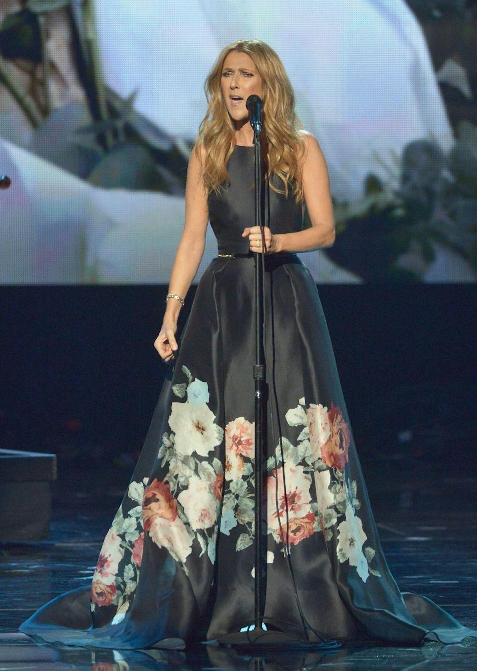 <p>Dion performed at the American Music Awards, wearing a flattering belted ball gown with floral detailing. Her beachy waves and minimal jewelry make the look less stuffy and more bohemian.</p>