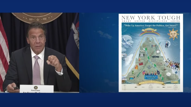Andrew Cuomo unveils his pandemic-themed poster to the press