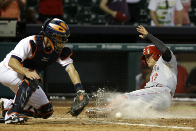 Cincinnati Reds' Shin-Soo Choo (17) beats the ball to home plate as Houston Astros catcher Matt Pagnozzi reaches for the ball in the 13th inning of a baseball game Wednesday, Sept. 18, 2013, in Houston. Choo scored on a bases-loaded hit by Jay Bruce. (AP Photo/Pat Sullivan)