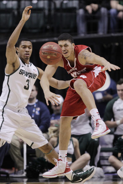 Wisconsin forward Rob Wilson, right, and Michigan State guard Brandan Kearney battle for the loose ball in the first half of an NCAA college basketball game in the semifinals of the Big Ten Conference tournament in Indianapolis, Saturday, March 10, 2012. (AP Photo/Michael Conroy)