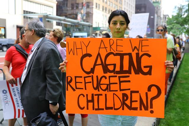 Ashley Portillo holds up a sign addressing immigration policy at the protest in New York City on June 20, 2018. (Photo: Gordon Donovan/Yahoo News)