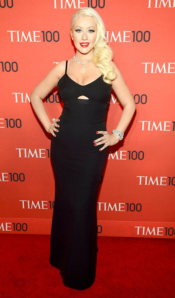 "Christina Aguilera stole the spotlight at Tuesday evening's star-studded Time 100 Gala at New York City's famed Lincoln Center. Before taking the stage to perform alongside fellow musician Miguel, the ""Beautiful"" songstress showed off her slimmed-down shape in a black, body-con gown, courtesy of Victoria Beckham. Side-swept tresses, signature red lipstick, and millions in Lorraine Schwartz jewels completed Xtina's divalicious red carpet comeback. (4/23/2013)<br>"