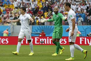 United States' goalkeeper Tim Howard yells to his teammates during the team's loss to Germany. (AP)