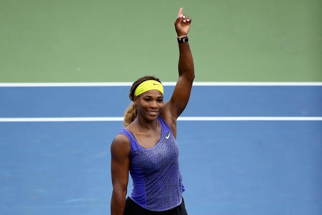 Serena Williams celebrates after beating Flavia Pennetta of Italy on Day 6 at the Western & Southern Open on August 14, 2014 at the Linder Family Tennis Center in Cincinnati, Ohio (AFP Photo/Andy Lyons)
