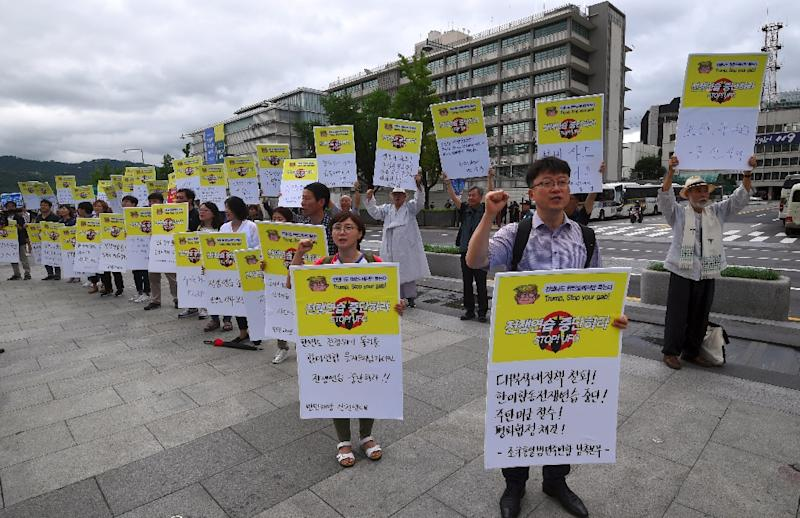 Protestors hold placards that read 'stop war exercise' during a rally denouncing the annual Ulchi Freedom Guardian (UFG) joint South Korea-US military exercise, near the US embassy in Seoul, on August 21, 2017 (AFP Photo/JUNG Yeon-Je)