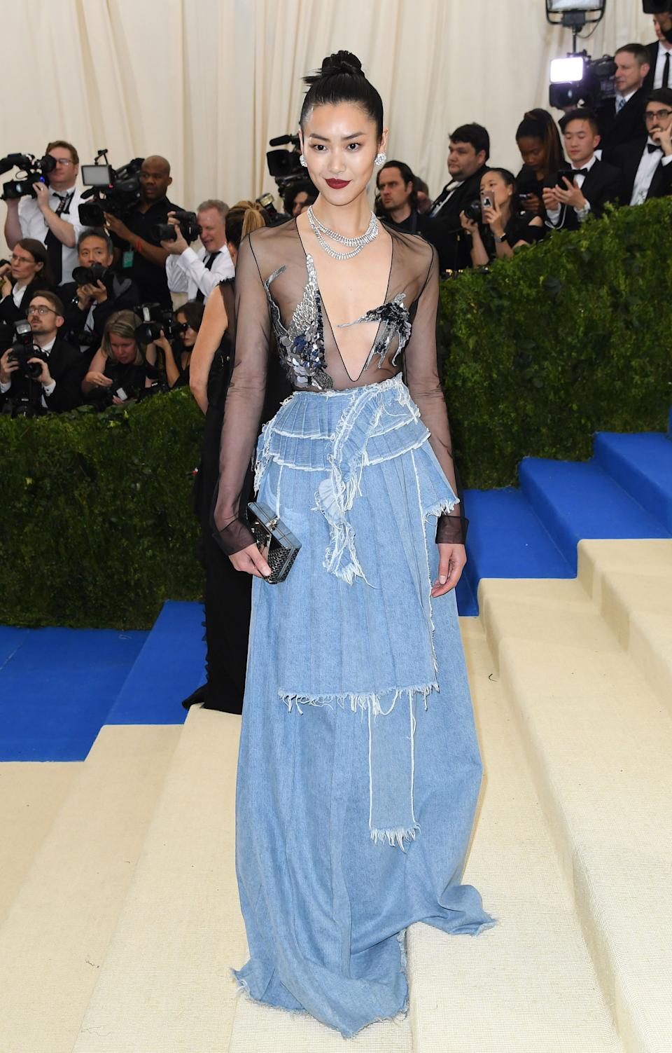 """<h1 class=""""title"""">Liu Wen in Off-White</h1><cite class=""""credit"""">Photo: Getty Images</cite>"""