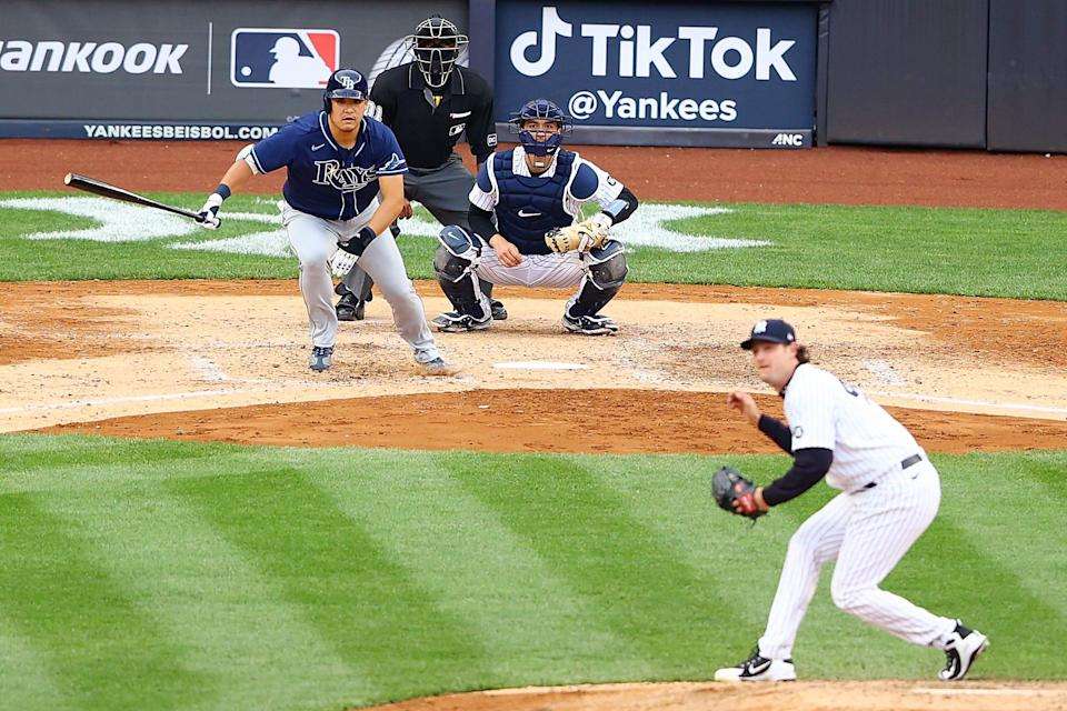 The Rays' Yoshi Tsutsugo hits a RBI double in the seventh inning against the New York Yankees on April 18, 2021.