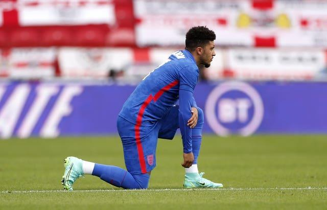 Jadon Sancho takes a knee before the Romania game