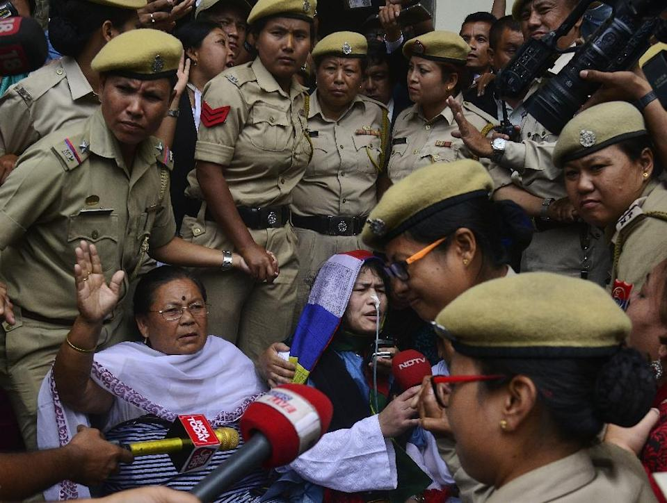 Indian rights activist Irom Sharmila (centre) talks to media after appearing before a District and Sessions Judge at Imphal West court in Imphal on August 9, 2016 (AFP Photo/Biju Boro)