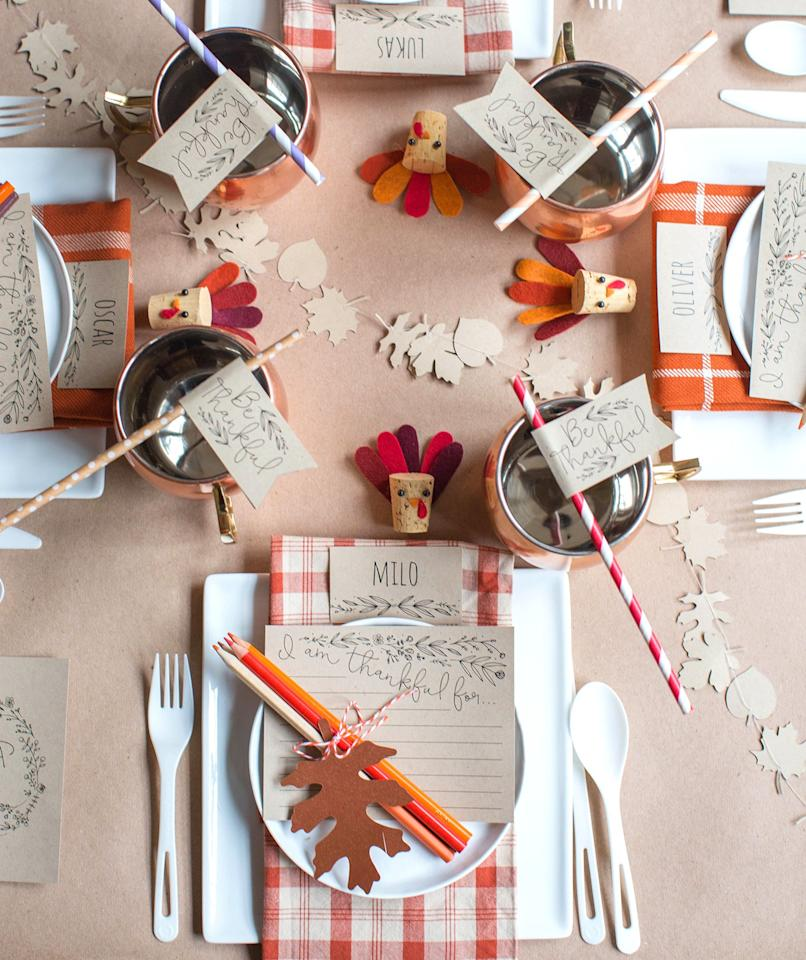 "<p>This adorable Thanksgiving kids' table from <a href=""https://liagriffith.com/thanksgiving-kids-table/?crlt.pid=camp.bJC1aGKG81WU"" target=""_blank"">Lia Griffith</a> proves that you don't need to spend a lot to make the table festive. Plus, it's proof that kids Thanksgiving table decorations don't have to be too kitschy. An inexpensive roll of craft paper stands in for a tablecloth—and the little ones will love that they can doodle on their placemat before dinner. The name cards, straw toppers, and menus can all be printed using the downloadable templates, so setting the cutest table is as easy as pressing ""print.""</p>"