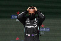 Mercedes driver Lewis Hamilton of Britain stands on the podium after winning the Portugal Formula One Grand Prix at the Algarve International Circuit near Portimao, Portugal, Sunday, May 2, 2021. (AP Photo/Manu Fernandez)