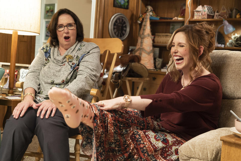 "This image released by Lionsgate shows Phyllis Smith, left, and Vanessa Bayer in ""Barb and Star Go to Vista Del Mar."" (Richard Foreman/Lionsgate via AP)"