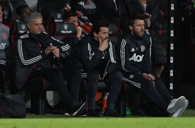 "Soccer Football - Premier League - AFC Bournemouth vs Manchester United - Vitality Stadium, Bournemouth, Britain - April 18, 2018 Manchester United manager Jose Mourinho checks his watch as assistant manager Rui Faria and Michael Carrick look on REUTERS/Ian Walton EDITORIAL USE ONLY. No use with unauthorized audio, video, data, fixture lists, club/league logos or ""live"" services. Online in-match use limited to 75 images, no video emulation. No use in betting, games or single club/league/player publications. Please contact your account representative for further details."